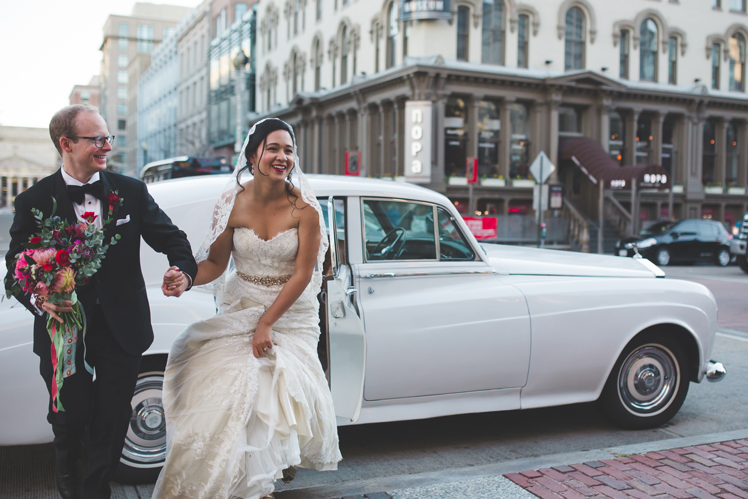 bride and groom exiting rolls royce